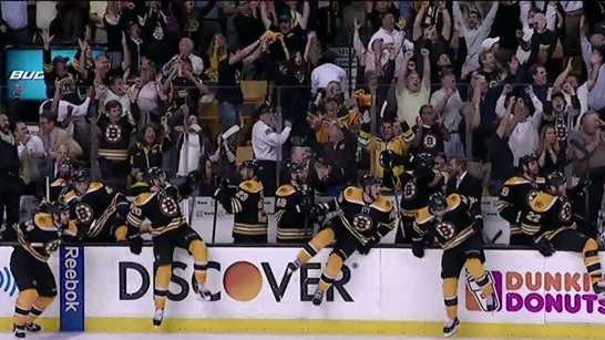 The Boston Bruins and their fans celebrate after a double-overtime victory in Game 3 of the Eastern Conference finals against the Penguins.