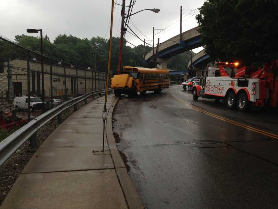 The car was in the wrong lane of West Warrington Avenue when it hit the bus head-on, Pittsburgh Public Schools spokeswoman Ebony Pugh says.