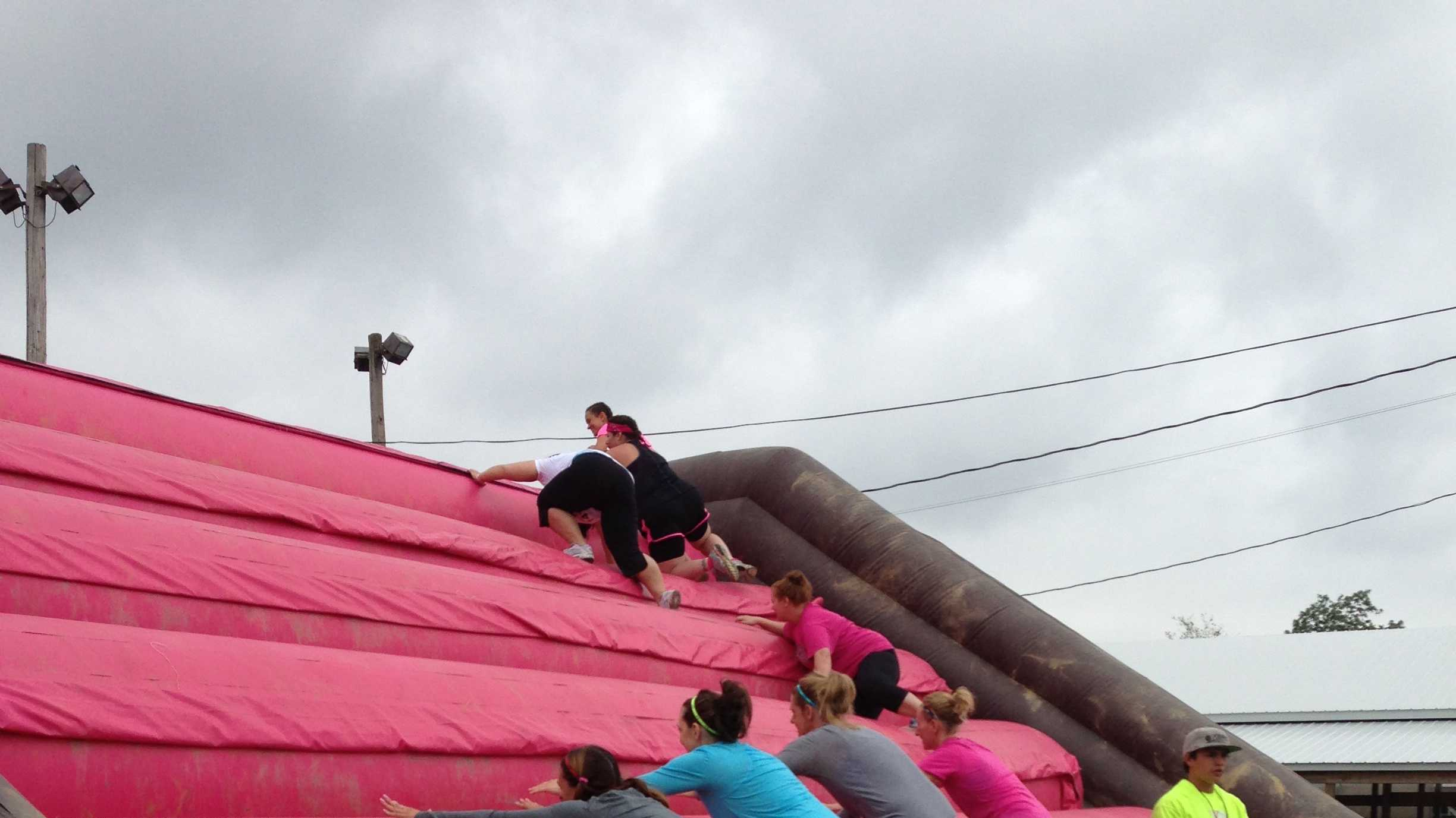 "The event featured several obstacles, including the ""Utopian Tubes"" tunnel crawl and ""PMS (Pretty Muddy Stuff)"" mud pit."