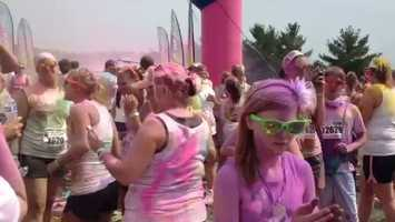 Color Me Rad provides runners with bright plastic sunglasses to protect their eyes from the color bombs.