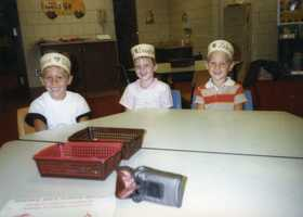 And here's a young Ashley on the first day of kindergarten with her childhood best friends, Travis D'Amico and Steven Zelesnak.