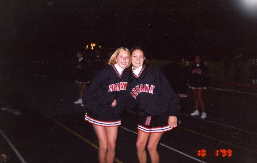 Here's Ashley cheerleading at a Mohawk football game. She was co-captain of her junior high and varsity squads.