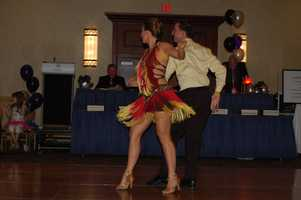 She's also competed on the dance floor. Here she is with her dance partner, Ray, at Dancing for a Cause in October.