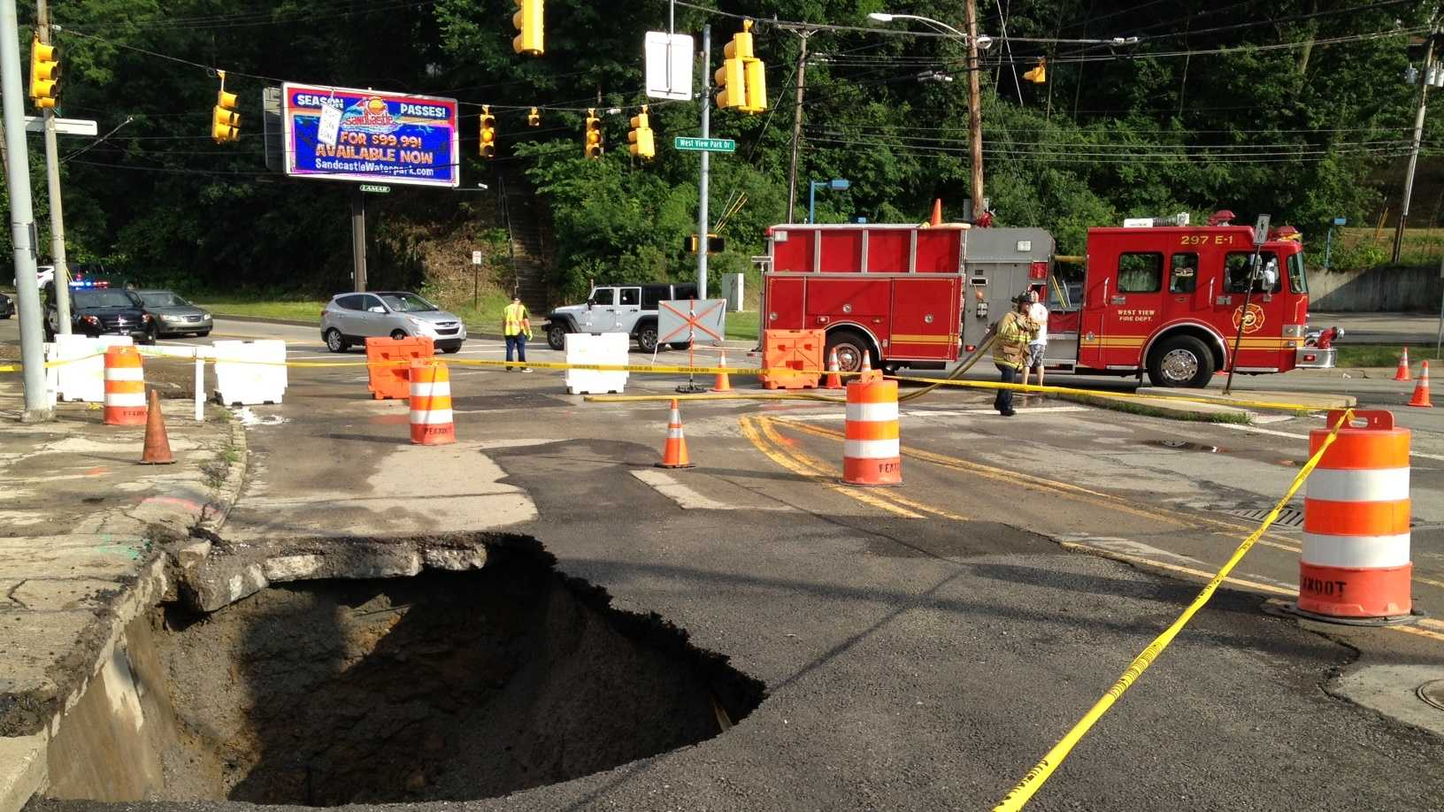 A large sinkhole has opened in a lane of traffic on Perry Highway in West View.