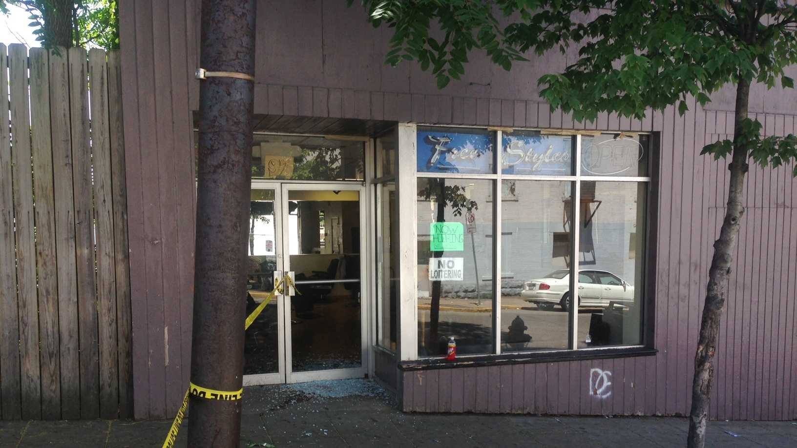 The glass door of a barbershop was shattered and shell casings littered a Knoxville street after two people were shot Wednesday afternoon.