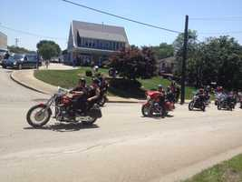 The Brothers of the Hammer motorcycle club escorted the casket of 46-year-old Vincent Kelley from Piatt and Barnhill Funeral Home, just four days after Kelley was shot and killed while trying to stop a bank robbery on Father's Day.