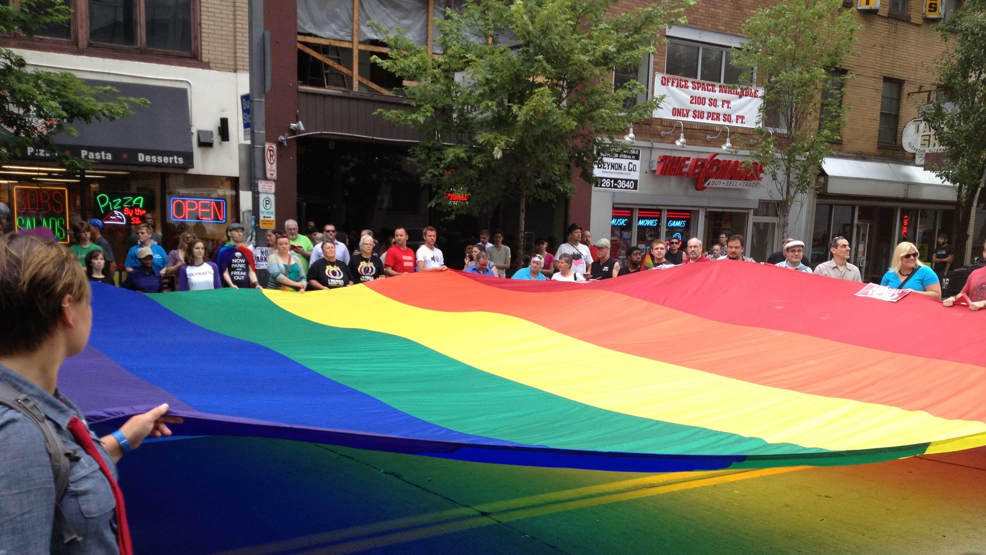 The rainbow flag is unfurled on Liberty Avenue.