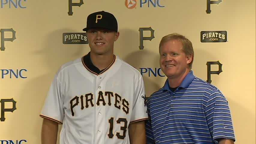 Top draft choice Austin Meadows joins Pirates GM Neal Huntington after signing a contract.