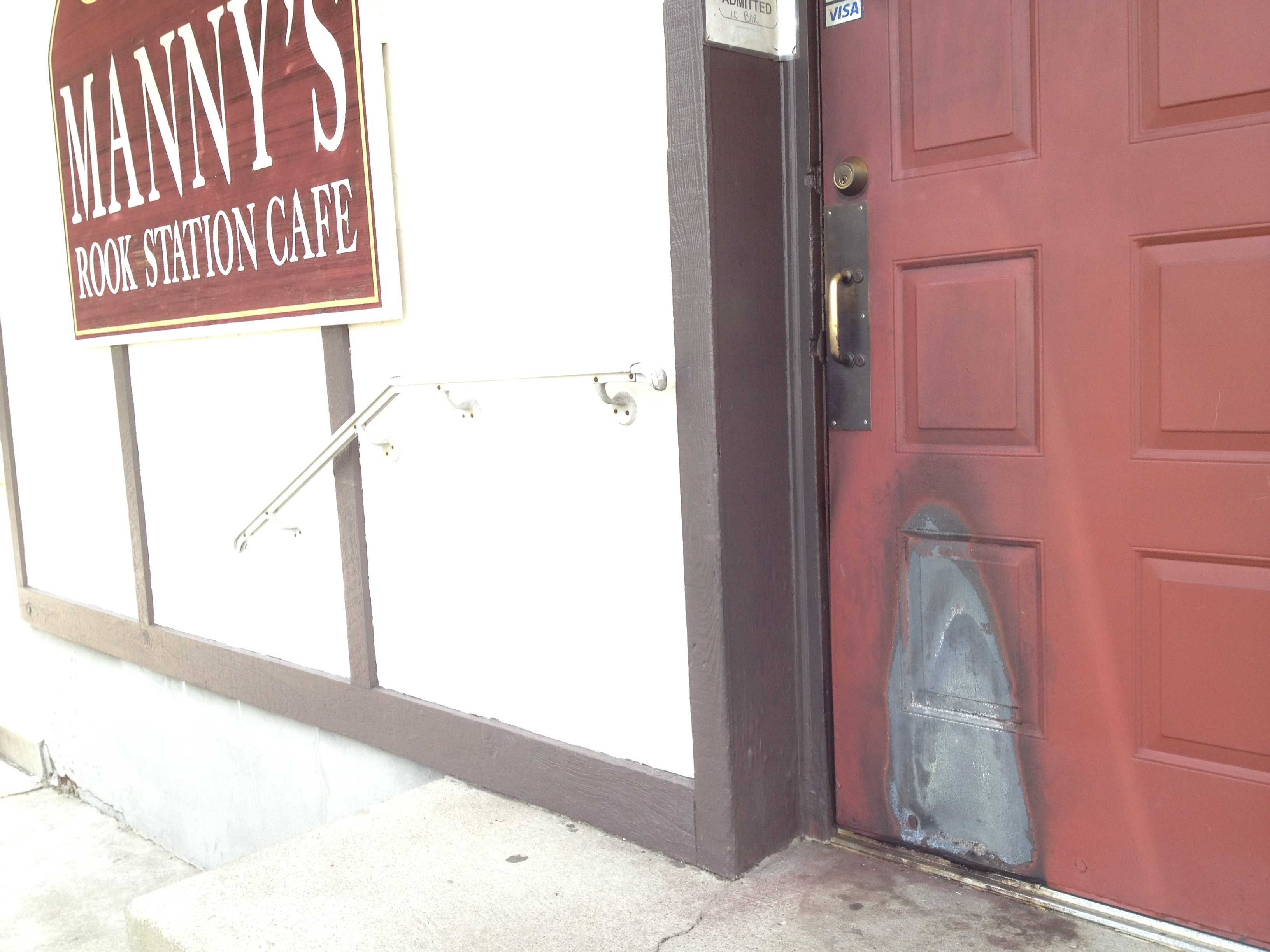 The door at Manny\u0027s Rook Station Cafe in Green Tree was damaged by what police said & Man accused of firebombing Green Tree bar