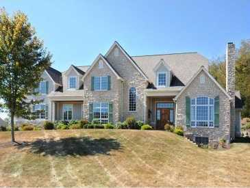 This house features five bedrooms and six bathrooms, and sits on 1.7 acres of land on Old Orchard Trail in Indiana Township. The home also includes a covered patio, pool, exterior fireplace, and is featured on realtor.com.