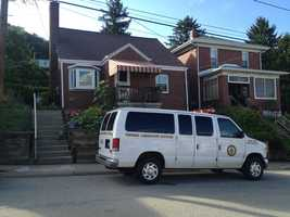 An Allegheny County Medical Examiner's van is parked outside the East Deer Township home of Jill Clark on July 5