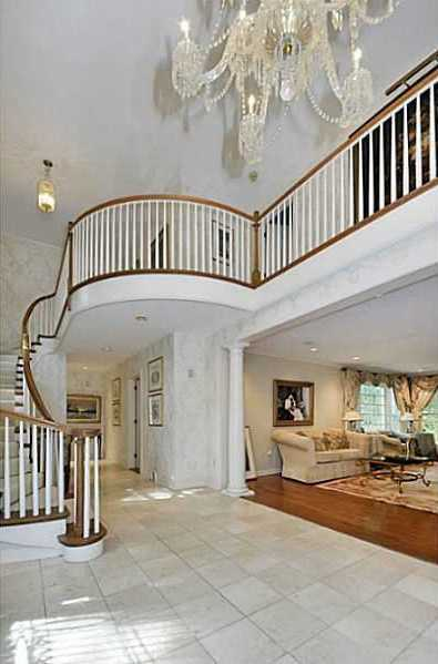 Alternate view of the foyer shows off the beautiful balcony and chandelier.
