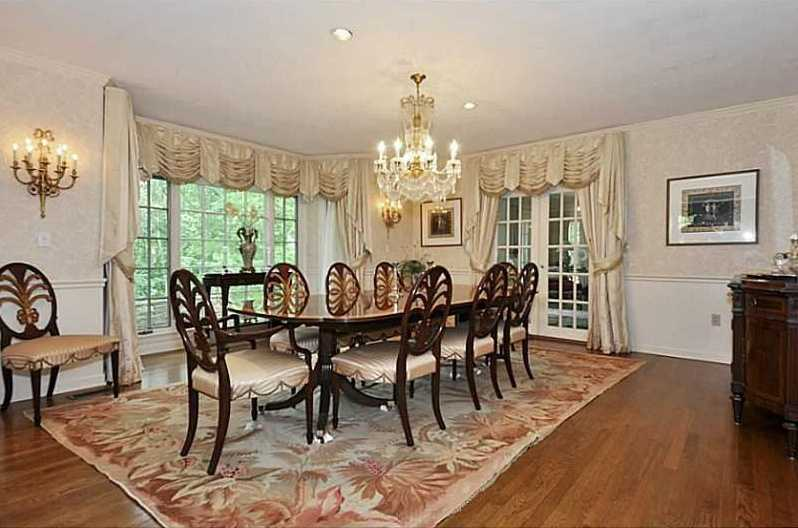 Formal dining room has a private entrance and an incredible view of the landscaped grounds.