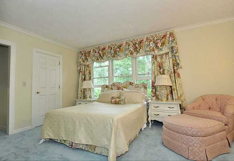 One of five bedrooms, perfect for your guest's stay. It features a walk-in closet and private bathroom.