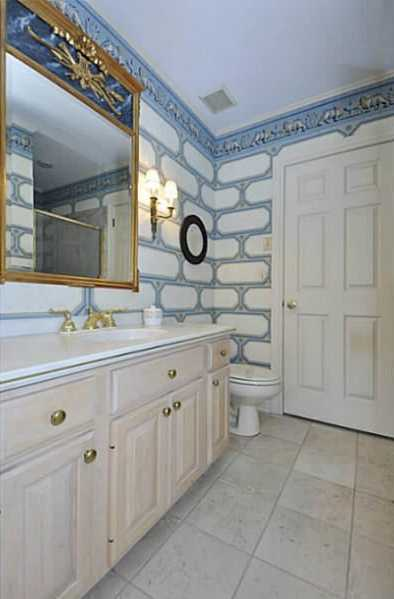Artistic decor is featured in this bathroom.