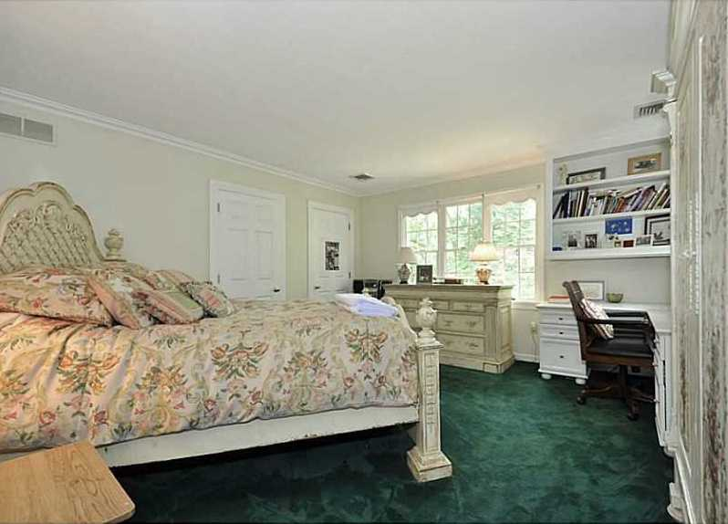 A second large guest bedroom. It always makes use of the space with a custom desk unit.
