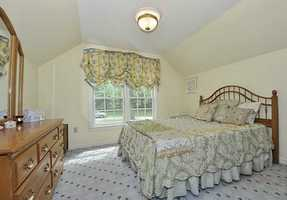 A quaint, yet classically beautiful bedroom.