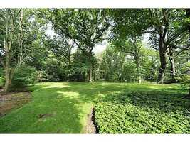 The backyard has been relatively untouched, but has potential for a large pool if you'd rather not embrace nature this closely. For more information on this home, simply visit Realtor.com.