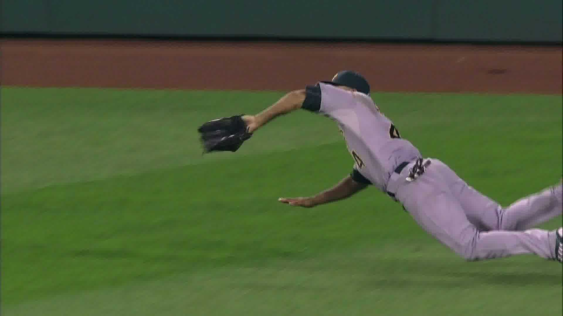Oakland's Coco Crisp robs the Pirates' Andrew McCutchen of extra bases with a diving catch.