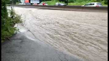 Banksville Road was swamped with water, making it impassable in sections.