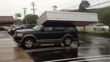 The sign outside Cort Furniture on McKnight Road in Ross Township fell onto a vehicle in the parking lot during a strong thunderstorm Wednesday.