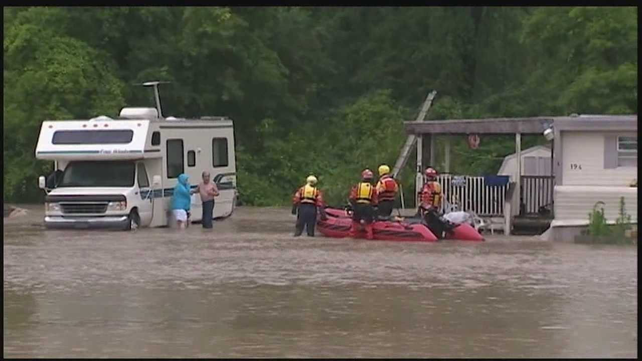 New Castle residents try to escape powerful floodwaters