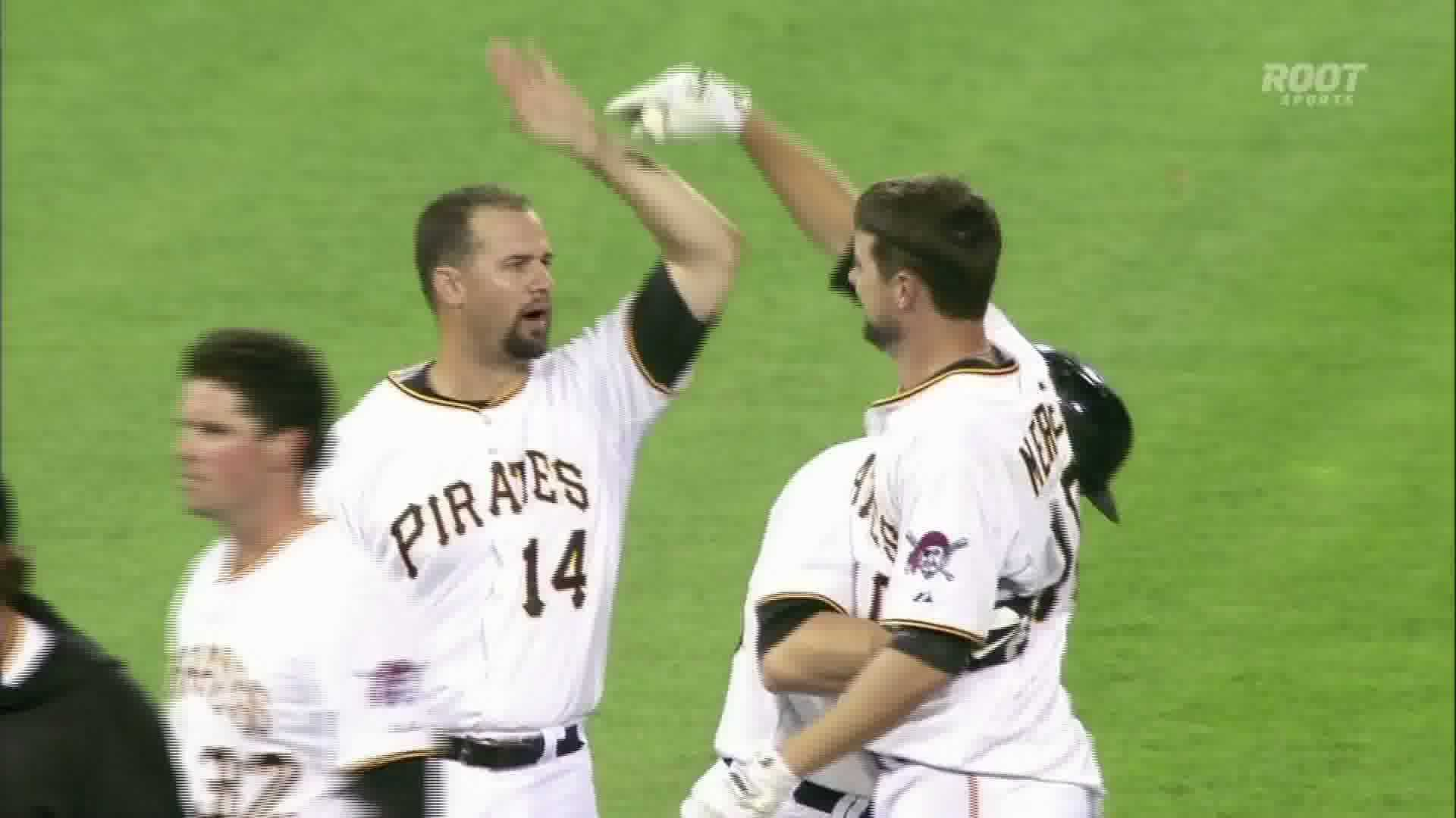 Jordy Mercer celebrates his 11th-inning RBI single, giving the Pirates a walk-off win.