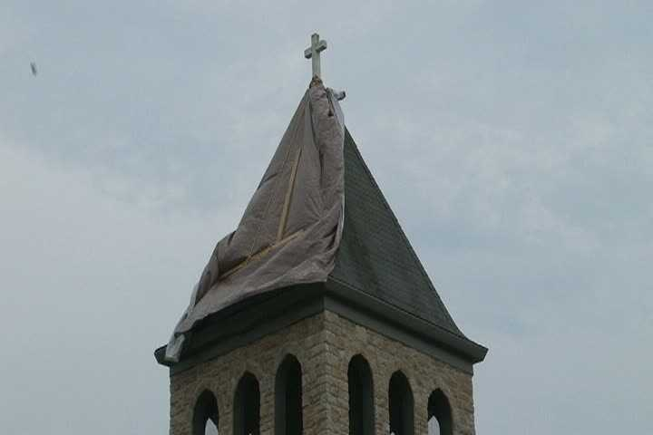 The steeple atop St. Cecilia Roman Catholic Church on Grindstone Road in Redstone Township was hit by lightning late Friday afternoon as storms passed through the area.