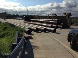 The truck was carrying pipes when its load shifted and it crashed near the corner of South Linden Street and South Duquesne Avenue (Route 837).