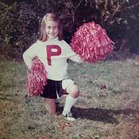 Michelle was a cheerleader at a young age and would go on to be a college cheerleader. She also played high school basketball and volleyball and pitched for the softball team. (It was a very small town!)