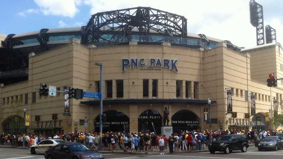 Pirates and Cardinals fans make their way into the ballpark.