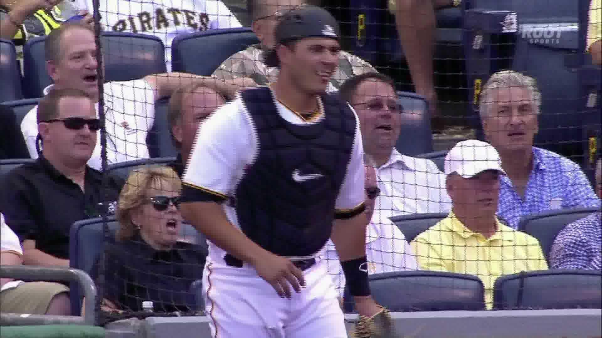 Pirates catcher Tony Sanchez reacts after St. Louis scores on a wild pitch.