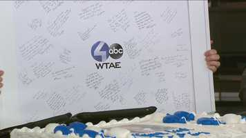 Friends and co-workers at WTAE wrote personal messages on a big going-away sign for Demetrius to take with him to his new home in Chicago.