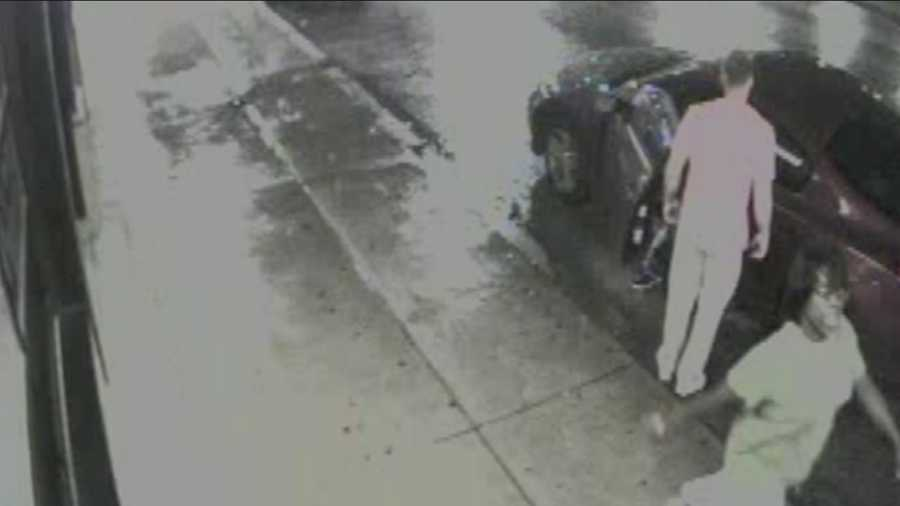 This is a surveillance video image of a woman who police say was with the two men.