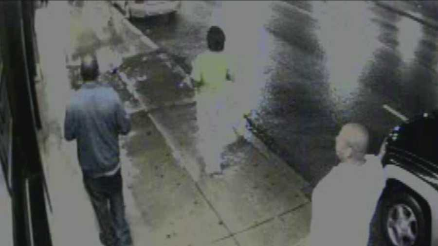 This is a surveillance video image of the man (in the white shirt) who police say fired the shot.
