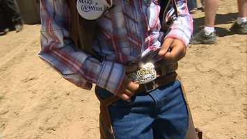 He got his very own belt buckle ...