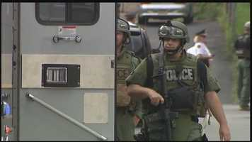 Pittsburgh Police are hunting for an armed man who threatened a woman with a machine gun, forcing the SWAT team to descend on West Oakland.