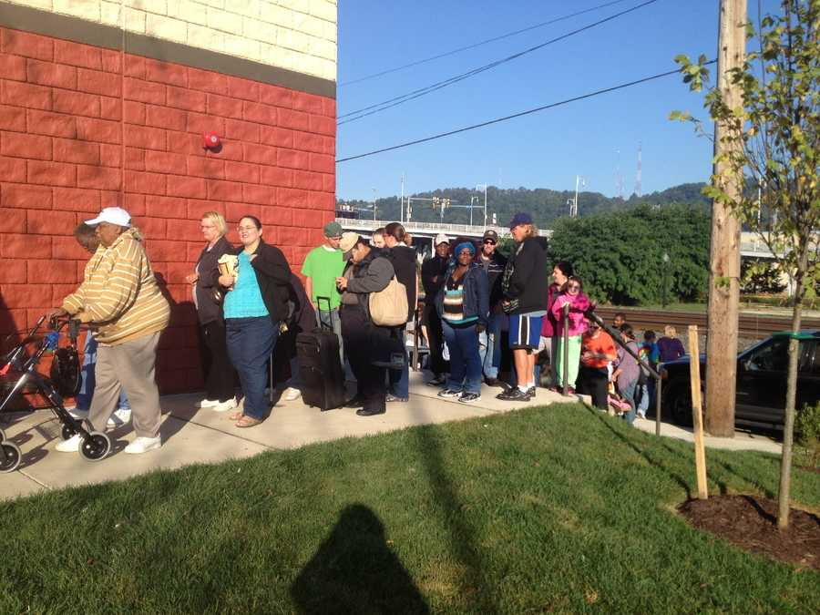 A long line of shoppers formed early outside the discount grocery store on East Seventh Street.