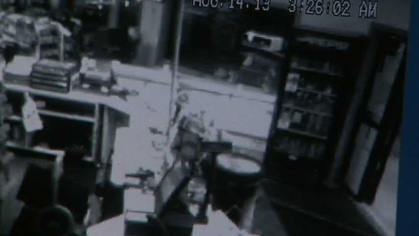 One of the thieves hooked the chain to the ATM. (Look in the upper left corner of this image, next to the flat white cooler.)