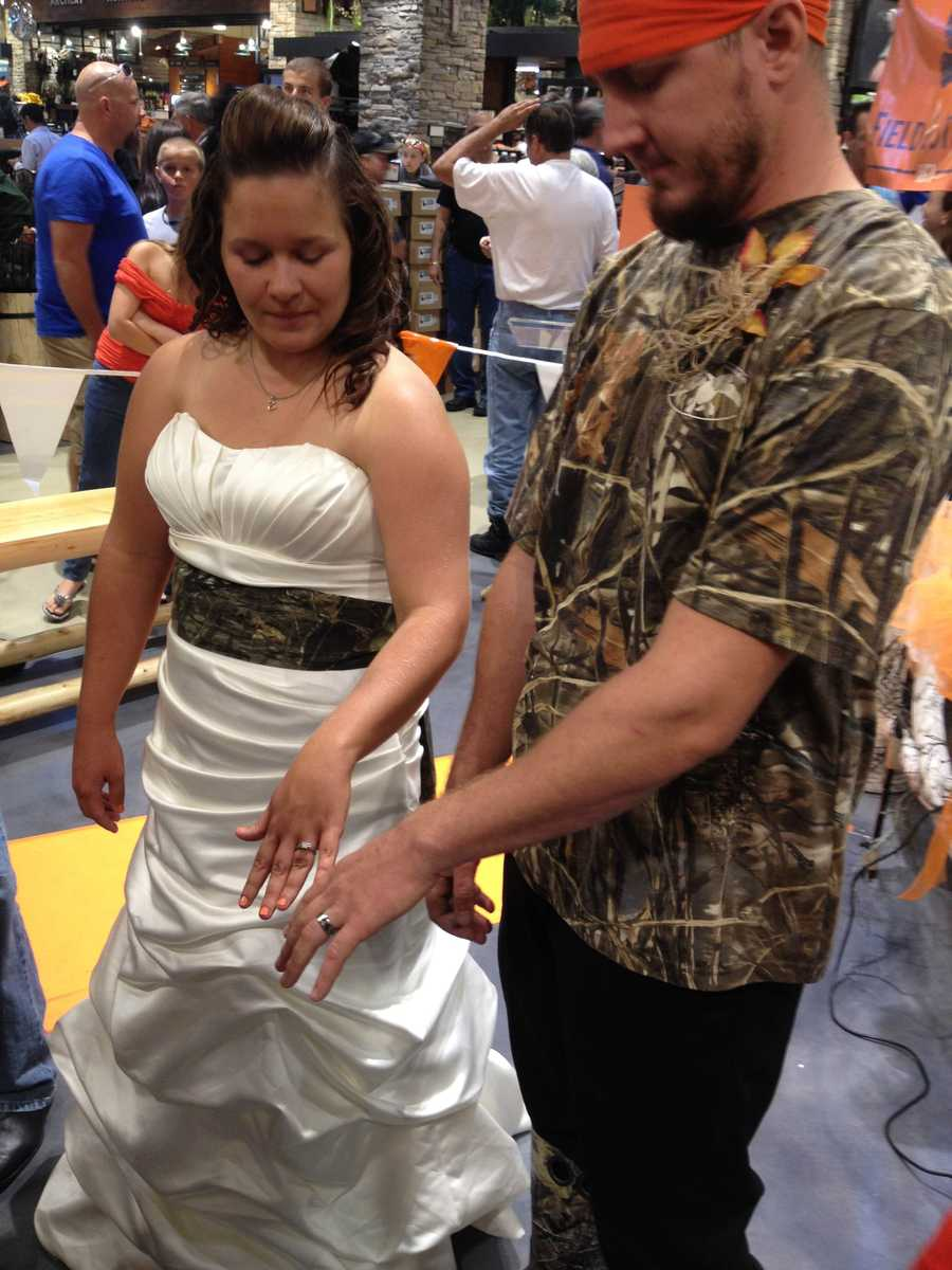 Cook, 26, of Beaver County wore a camouflage sash as she was married under an arbor of animals.