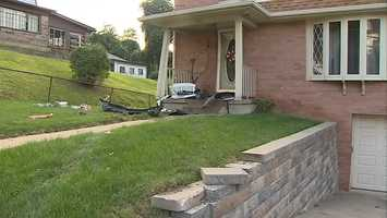 A Mt. Washington family is looking at a big repair job after someone drove a vehicle into the front wall of their home.