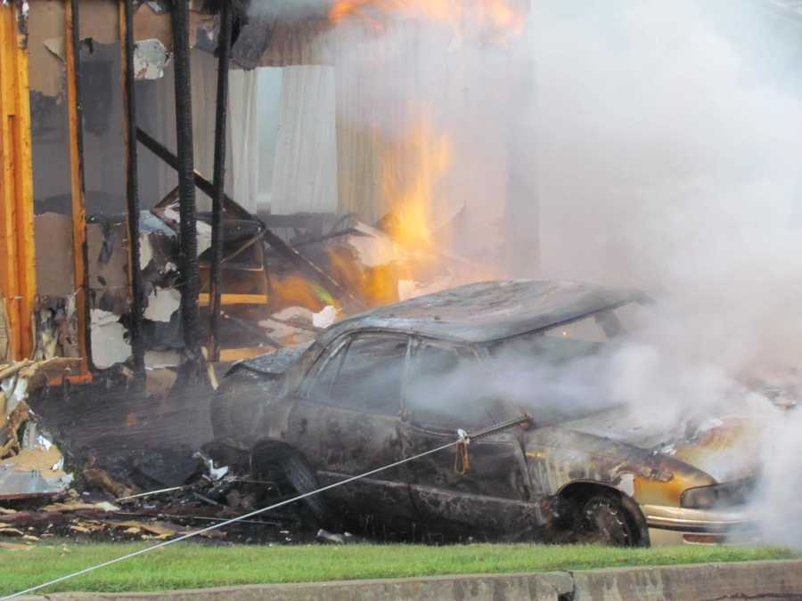 The driver was not injured, and no one was inside the house at the time, but the home and car were destroyed by the flames.