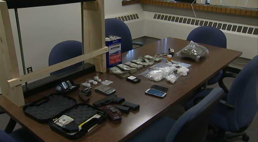 A half-kilo of cocaine, 2 pounds of marijuana, several dozen OxyContin pills, two handguns and $6,000 in cash were among the items confiscated, police said.