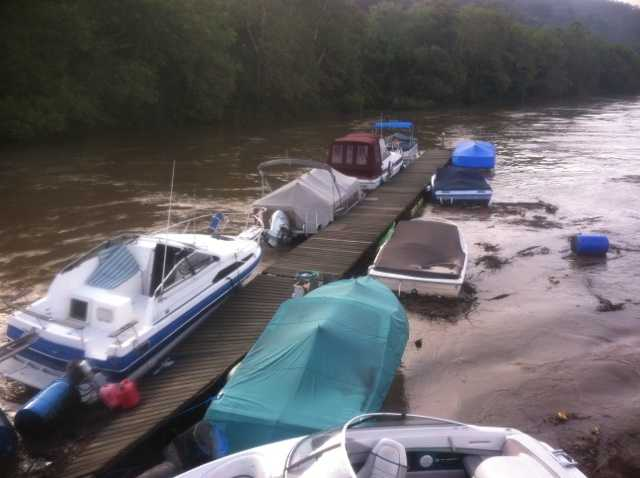 A dock with nearly a dozen boats attached to it broke free Thursday morning and drifted down the Monongahela River until a towboat operator stopped them from reaching a dam.