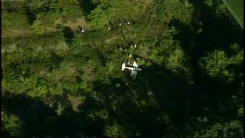 A small plane landed in trees and brush late Friday afternoon just off a runway at the Beaver County Airport.