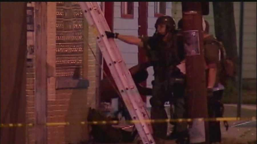 The man was pulled out of the home head-first by a SWAT team.