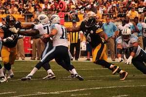 LaMarr Woodley sacks Titans quarterback Jake Locker.
