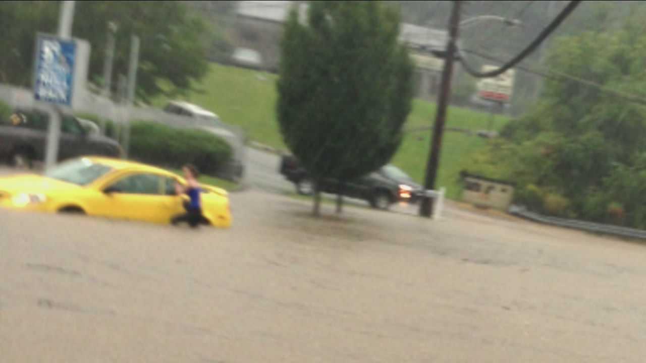 Heavy rainfall brings flooding, lightning blamed in fire