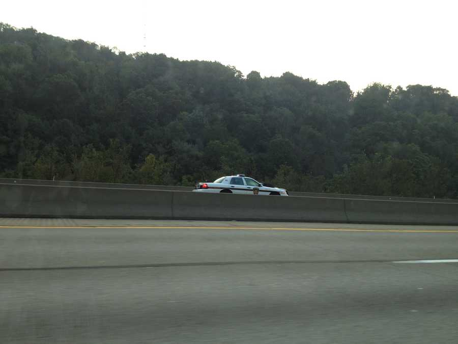 A state police car in the HOV lane on Interstate 279.