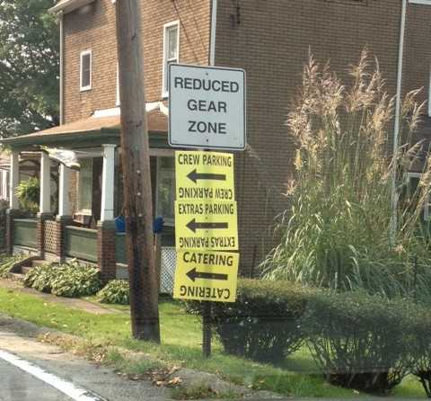 Neighbors said Penhurst Drive is blocked by a township police car, and yellow signs are posted on utility poles to direct movie crew members toward catering and parking.